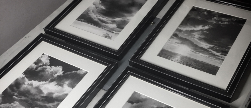 Four framed charcoal drawings